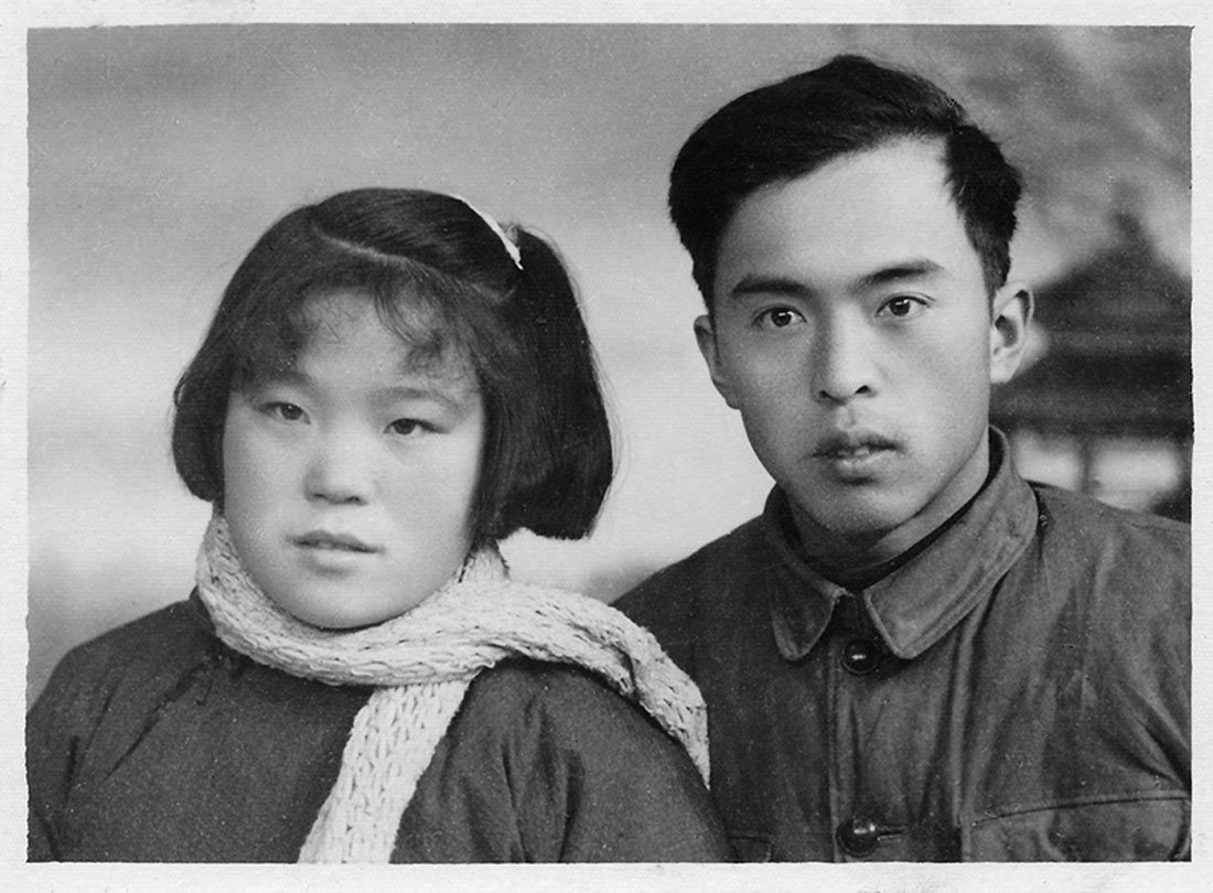 Mr Jia's parents after arrival in Xinjiang, his father to take up aCompany Commander position in the bingtuan, 1963. The bingtuan was set up as a military-agricultural colony in the early 1950s. Demobilised soldiers of both the Communists and their civil war enemies, the Nationalists, settled marginal arid lands, building extensive irrigation networks with hand tools and sheer force of numbers.