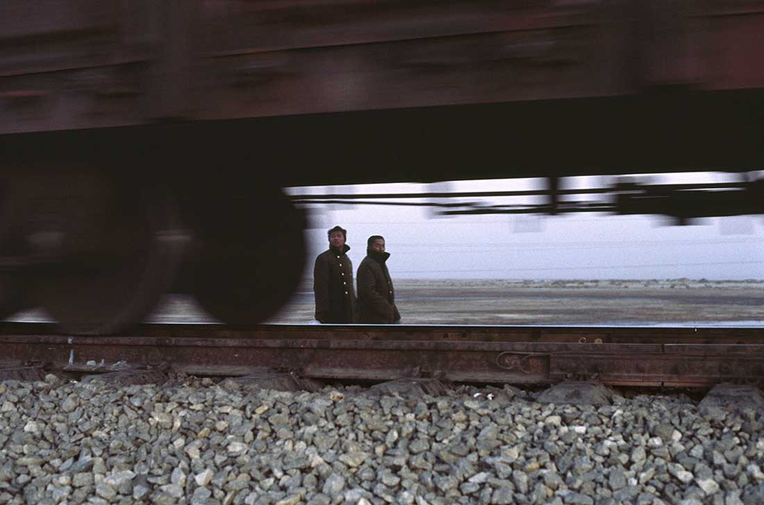 Train series. Migrant track workers returning home after a day's work. North of Korla, October 2009.